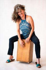Linette Tobin sitting on drum box